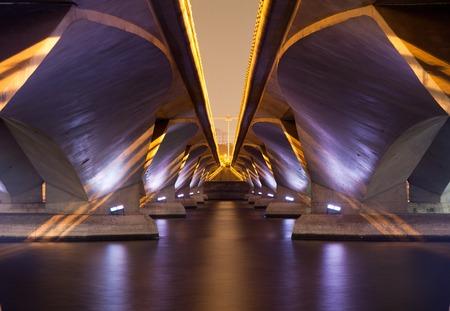 A light show and shadow of under Esplanade Bridge, Singapore.