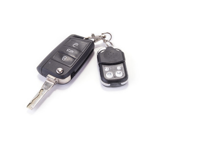 Car key with garage remote control on the white