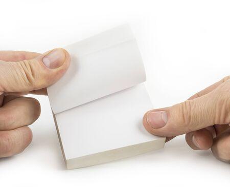 Photo pour Block of paper notes hold with fingers - image libre de droit