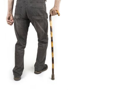 Photo pour Retired man with cane in jacket on white - image libre de droit