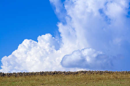 Clouds and wall is a suggestive vison in the elements constrast in the sicilian hinterland