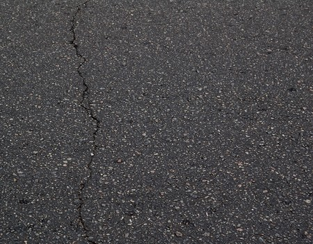 Photo for Old Black Asphalt Texture with a Crack. Asphalt Background with Space for Text. - Royalty Free Image
