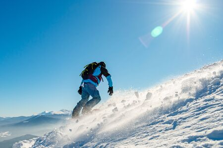 Photo for Snowboarder Riding Snowboard in the Mountains at Sunny Day. Snowboarding and Winter Sports - Royalty Free Image