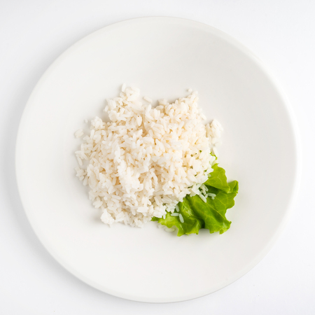 rice on the white plate, top view