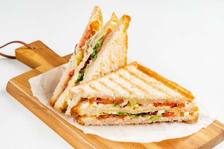Photo pour Sandwich with ham, cheese, tomatoes, lettuce, and toasted bread. - image libre de droit