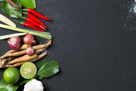 Photo pour Herb ingredient of Tom Yum spicy soup Traditional Thai food cuisine on black background - image libre de droit