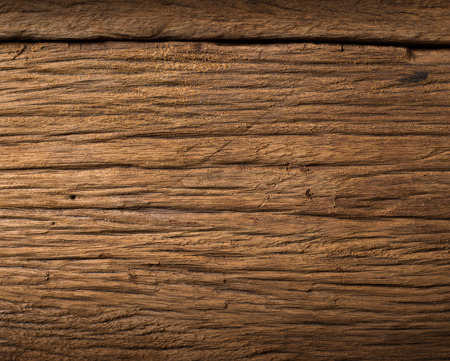 Nature dark brown wood stain close up texture backgroundの写真素材
