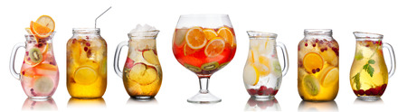 Collection of different summer party drinks in bulk glasses. Pitchers,jugs and jars filled with sangria,spritzers,detox and infused waters.