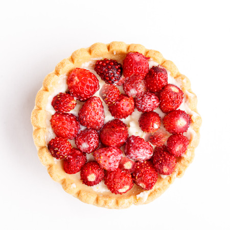 Dessert with wild strawberries.  Sweet tart with wild strawberry