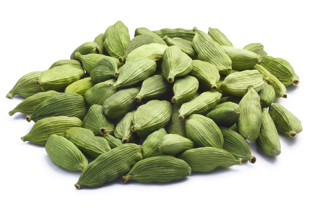 Pile of green Cardamom, cardamon or cardamum (dried fruits of Elettaria cardamomum). Clipping paths, shadow separated