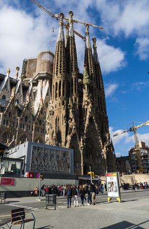 Barcellona, Spain, March 3, 2015: Tourists visit the Sagrada Familia by Antoni Gaudi