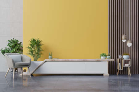 Foto de Cabinet TV in modern living room with armchair,lamp,table,flower and plant on yellow wall background,3d rendering - Imagen libre de derechos