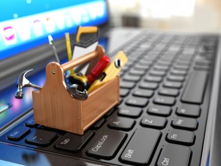 Foto de Toolbox with tools on laptop - Imagen libre de derechos