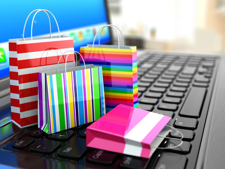 E-commerce. Online internet shopping. Laptop and shopping bags. 3dの写真素材