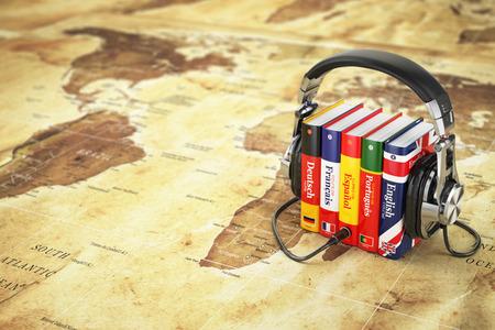 Photo pour Learning languages online. Audiobooks concept. Books and headphones on the map world. 3d - image libre de droit