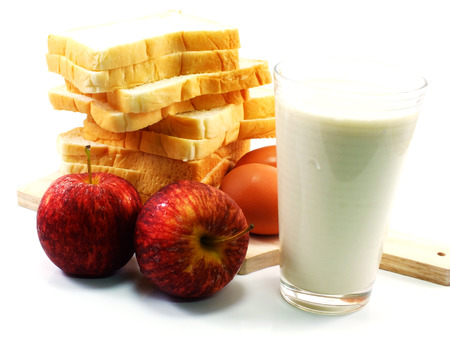 red apples and slice bread with milk for breakfast in morning
