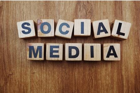 Foto de Social Media word created with cubes alphabet letters on wooden background - Imagen libre de derechos