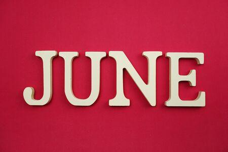 Photo pour June alphabet letter with space copy on pink background - image libre de droit