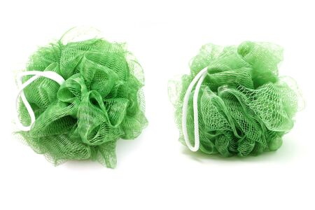 Foto de Green bath soft with rope isolated on white background - Imagen libre de derechos