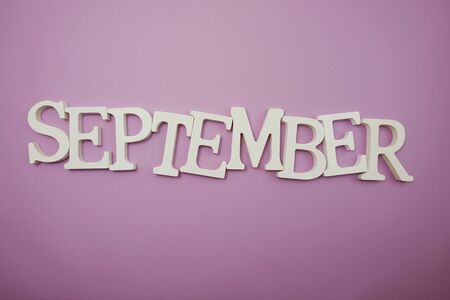 Foto de September alphabet letters on purple background - Imagen libre de derechos