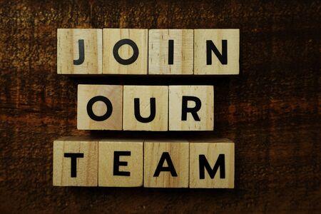 Photo pour Join Our Team text message on wooden background - image libre de droit
