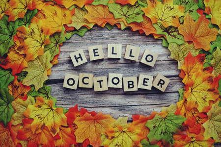 Photo pour Hello October alphabet letter with pumpkin and maple leaves decoration on wooden background - image libre de droit