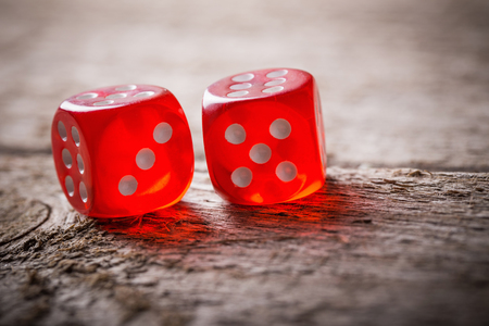 Photo pour Pair of thrown red dices on old wooden table - image libre de droit