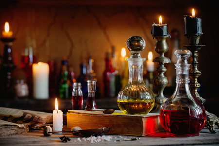 Magic potion, ancient books and candles: Royalty-free images