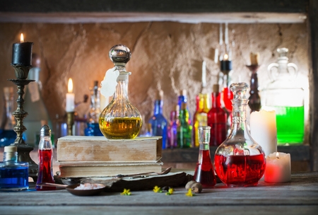 Photo for Magic potion, ancient books and candles - Royalty Free Image