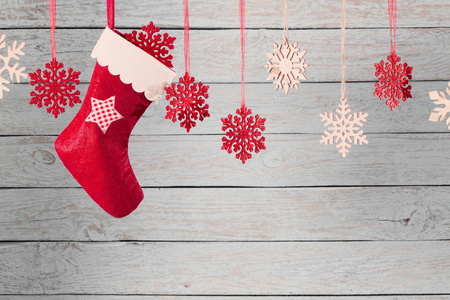 Photo for Christmas stocking hanging against wooden background - Royalty Free Image
