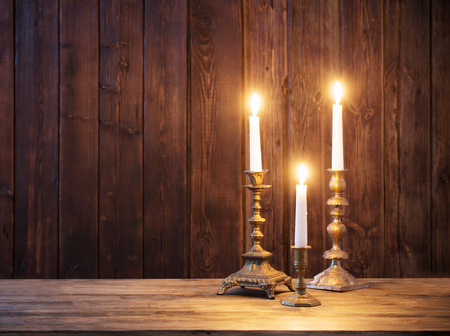 Photo for burning candle on old dark  wooden background - Royalty Free Image
