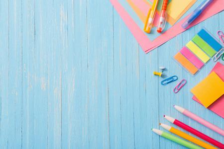 Foto de school supplies on  blue wooden background - Imagen libre de derechos