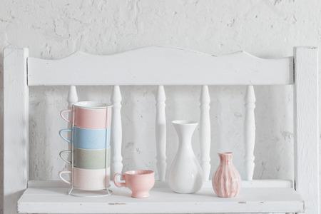 Photo pour cups and vase  on vintage white shelf - image libre de droit