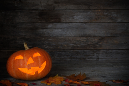 Foto de Halloween pumpkin on old wooden background - Imagen libre de derechos