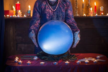 Photo pour female hands of fortune teller with illuminated crystal ball - image libre de droit