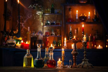 Photo for magic potions in bottles on wooden background - Royalty Free Image