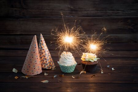 Tremendous Birthday Cake With Sparkler On Old Wooden Background Royalty Free Funny Birthday Cards Online Inifodamsfinfo