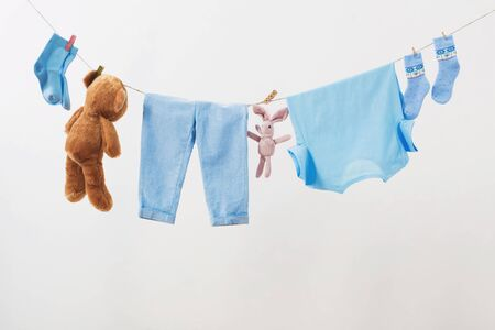 Photo for baby clothes hanging on  rope on white background - Royalty Free Image