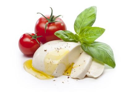 Foto de Mozzarella with tomatos and basil leaves isolated - Imagen libre de derechos
