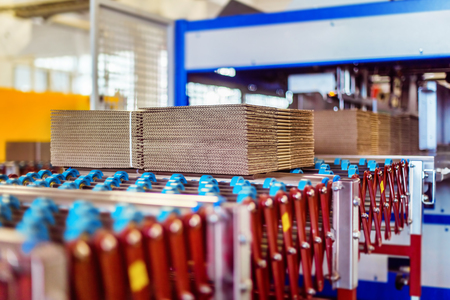 Photo for Closeup image of cardboard boxes on conveyor belt in distribution warehouse - Royalty Free Image