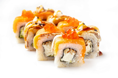 Foto de Closeip image of classic philadelphia sushi rolls with salmon, cream cheese, eel and red caviar isolated at white background. - Imagen libre de derechos