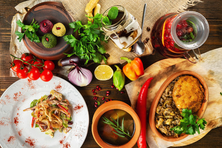 Photo pour Top view image of traditional georgian lunch with various meals and ingredients at decorated wooden table background. - image libre de droit