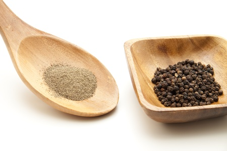 Peppercorn in wooden bowl