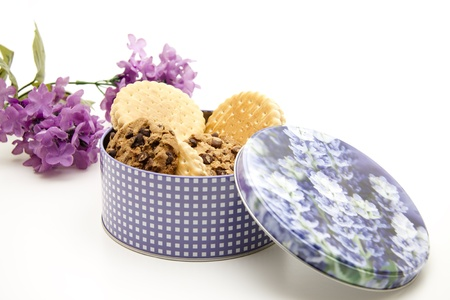 Chocolate biscuits in tin and flower