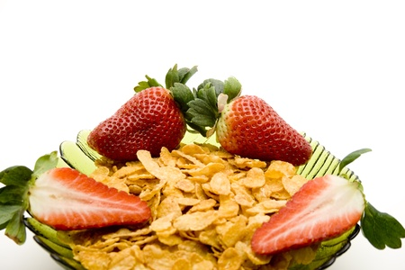 Fresh strawberries with cereals in the glass peel