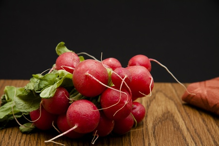 Radishes on dark background