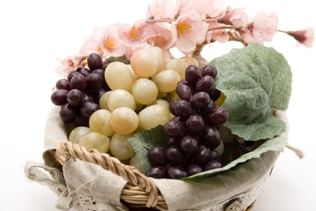 Wine grapes in the basket with flower branch