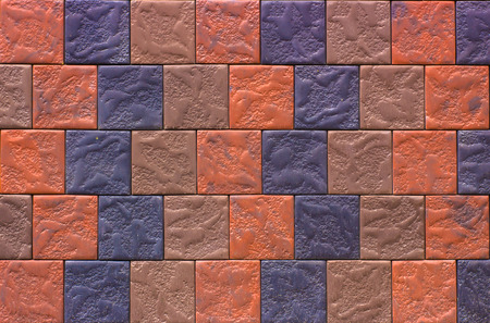 Decorative brick wall from concrete facing tiles as background or texture