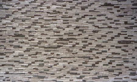 Decorative brick wall from concrete facing tiles as background or texture.