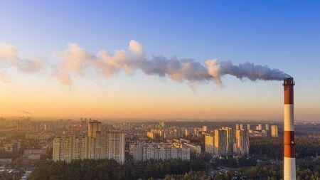Foto für The boiler pipe produces harmful gases into the atmosphere. Climate change. - Lizenzfreies Bild